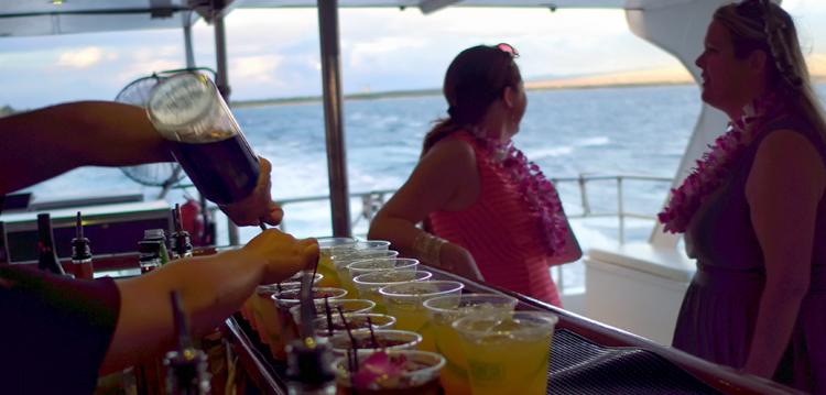 on pride bartender pours drinks