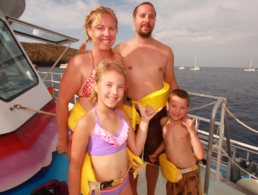 Family of four on the Pride of Maui boat.