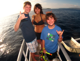 Woman with her sons on the bow of the Pride of Maui.